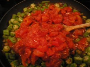 Add tomatoes and seasonings.  Stir well.